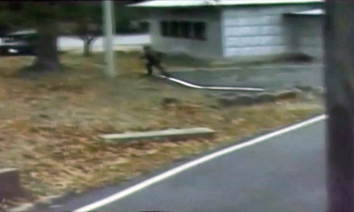 A CCTV still image shows a North Korean soldier crossing the white Military Demarcation Line during a United Nations Command (UNC) briefing on the investigation results of the soldier's defection, at the South Korean defence ministry in Seoul in this still image taken from a Reuters TV video, Nov. 22, 2017. (Reuters/Reuters TV)