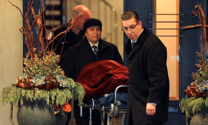 """One of two bodies is removed from the home of billionaire founder of Canadian pharmaceutical firm Apotex Inc., Barry Sherman and his wife Honey, who were found dead under circumstances that police described as """"suspicious"""" in Toronto, Ontario, Canada, Dec. 15, 2017. (Reuters/Chris Helgren)"""
