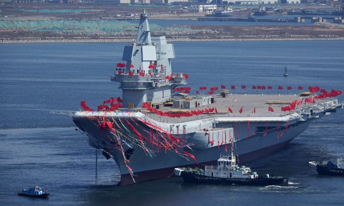 Type 001A, China's second aircraft carrier, is seen during a launch ceremony at Dalian shipyard in Dalian, northeast China's Liaoning Province, on April 26, 2017. China has achieved a critical breakthrough in its electromagnetic aircraft launch system that will allow its future carriers to launch heavier and more powerful aircraft. (STR/AFP/Getty Images)