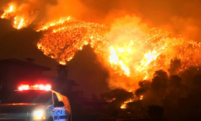 Thomas wildfire burns above Bella Vista Drive near Romero Canyon in this social media photo by Santa Barbara County Fire Department in Montecito, California on Dec. 12, 2017. (Mike Eliason/Santa Barbara County Fire Department/Handout via Reuters)