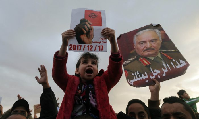 Supporters of Eastern Libyan military commander Khalifa Haftar take part in a rally demanding Haftar to take over, after a U.N. deal for a political solution missed what they said said was a self-imposed deadline on Sunday, in Benghazi, Libya, Dec. 17, 2017. (Reuters/Esam Omran Al-Fetori)