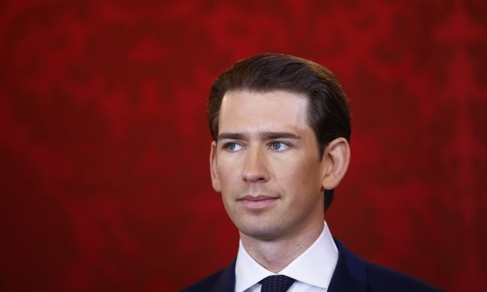 Head of the People's Party Sebastian Kurz reacts during the swearing-in ceremony of the new government in Vienna, on Dec. 18, 2017 (REUTERS/Leonhard Foeger)