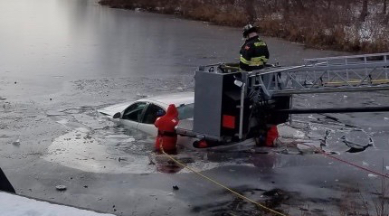 Emergency responders remove a car from Johnsons Pond, Groveland, Mass. on Dec 16. (Groveland Police and Fire Departments)