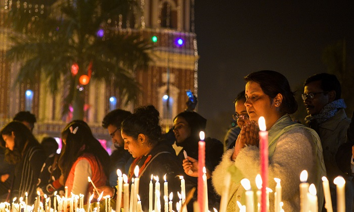 A file image of Indian people lighting candles during a Christmas Eve service at the Sacred Heart Cathedral in New Delhi on Dec. 24, 2016. (Chandan Khanna/AFP/Getty Images)