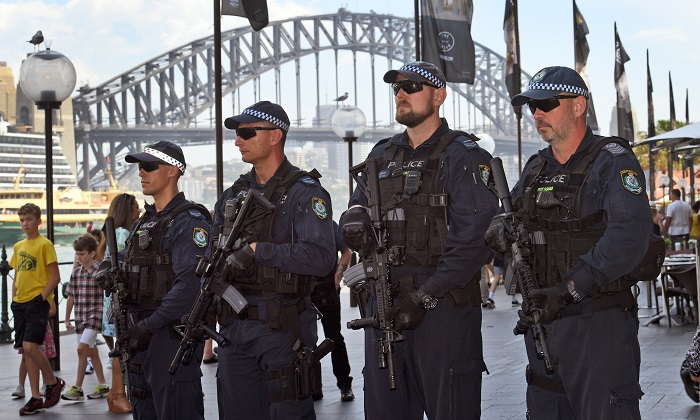 Members of the New South Wales (NSW) state riot squad police carry Colt M4 semi-automatic rifles which are now being used during large gatherings over the holidays as part of an increase in security against terrorism. (William West/AFP/Getty Images)