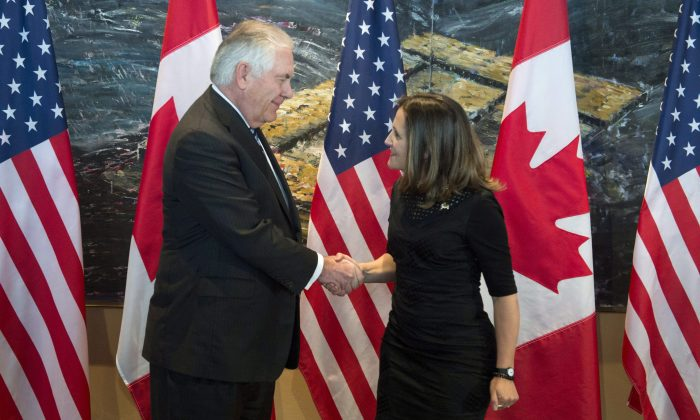 Foreign Affairs Minister Chrystia Freeland shakes hands with U.S. Secretary of State Rex Tillerson in Ottawa on Dec. 19, 2017. (The Canadian Press/Adrian Wyld)