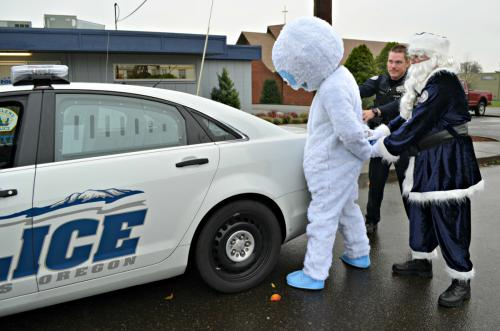 """Officer Claus """"arrested"""" Abominable Snowman on Dec. 18, 2017, as part of a campaign to crackdown on impaired driving. (St. Helens Police Department)"""