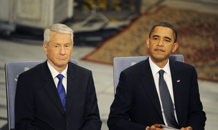 Chairman of the Norwegian Nobel Committee Thorbjoern Jagland (L) sits by Nobel Peace Prize laureate President Barack Obama during the prize award ceremony at City Hall in Oslo on Dec. 10, 2009. (OLIVIER MORIN/AFP/Getty Images)