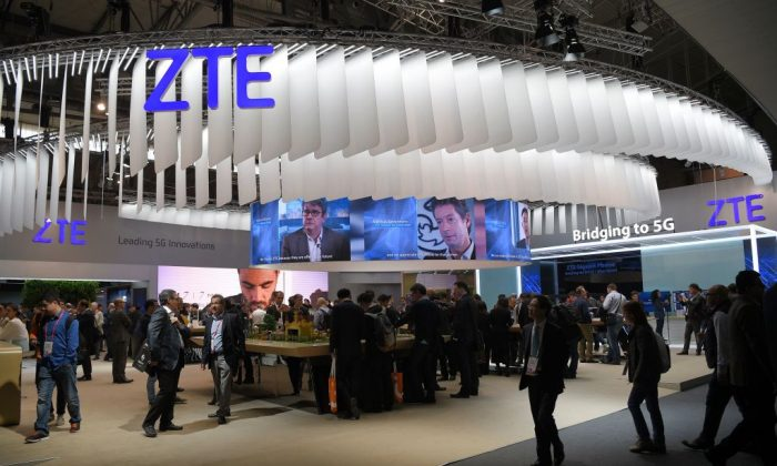 Visitors pass in front of the ZTE stand on the first day of the Mobile World Congress in Barcelona on Feb. 27, 2017. (Lluis Gene/AFP/Getty Images)