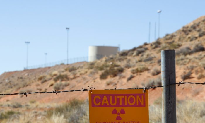 A radioactive warning sign hangs on fencing around the Anfield's Shootaring Canyon Uranium Mill on Oct. 27, 2017 outside Ticaboo, Utah. Anfield with is in partnership with the Russian firm Uranium One, and bought the mill from Uranium One in 2015. (George Frey/Getty Images)