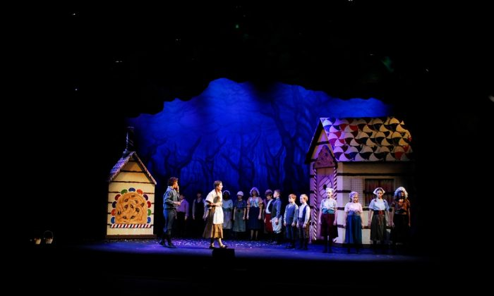 "Hansel (Sarah Klopfenstein) and Gretel (Samantha Jeffreys) discover with surprise that children have been released from their gingerbread state, in a Nashville Opera production of ""Hansel and Gretel"" directed by Stuart Holt. (Reed Hummell/Nashville Opera)"