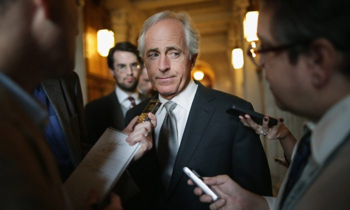 Sen. Bob Corker (R-TN) talks with reporters before attending the weekly Republican Senate caucus policy luncheon at the U.S. Capitol on Nov. 5, 2013 in Washington, DC. (Chip Somodevilla/Getty Images)