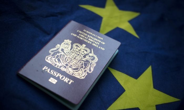 A British passport in front of the flag of the European Union. (Matt Cardy/Getty Images)