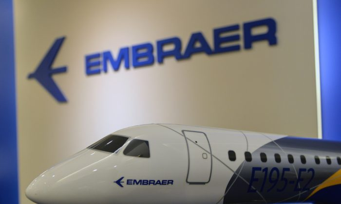 A display model of an Embraer E195 medium-range airliner is seen on display at the Embraer Asia Pacific office in Singapore June 29, 2017. (Roslan Rahman/AFP/Getty Images)