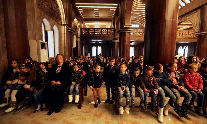 Iraqi Christian children attend a mass at Church of Saint George in Teleskof, Iraq Dec. 24, 2017.  (Reuters/Ari Jalal)