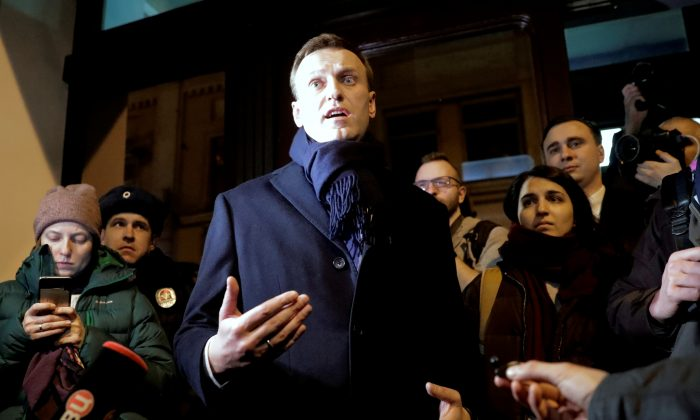 Russian opposition leader Alexei Navalny speaks to the media after submitting his documents to be registered as a presidential candidate at the Central Election Commission in Moscow, Russia, on Dec. 24, 2017. (Tatyana Makeyeva/Reuters)