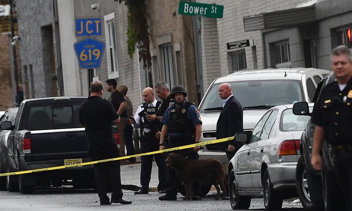 Law enforcement officers secure the area where they allegedly arrested terror suspect Ahmad Khan Rahami following a shootout in Linden, N.J., on Sept. 19, 2016. (Jewel Samad/AFP/Getty Images)