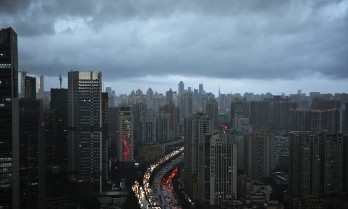 Dark clouds cover the Guangzhou City skyline in Guangdong Province of China, on May 22, 2014. (VCG via Getty Images)