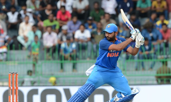 Indian cricketer Rohit Sharma plays a shot during the fourth one day international (ODI) cricket match between Sri Lanka and India at R. Premadasa Stadium in Colombo on August 31, 2017. (Lakruwan Wanniarachchi Anniarachichi/AFP/Getty Images)
