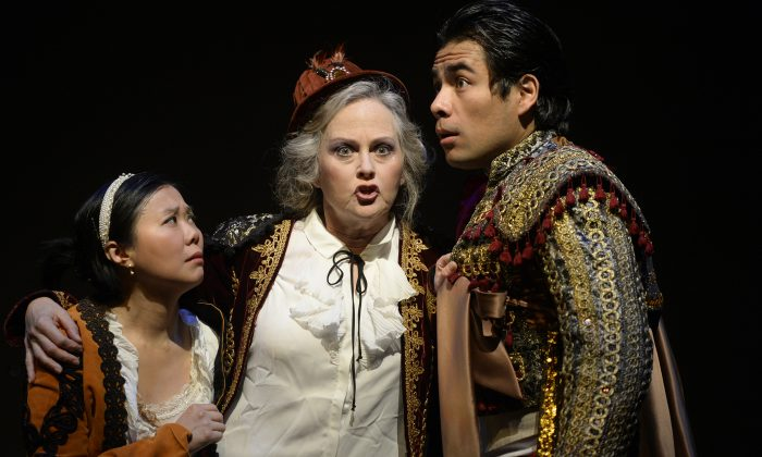 """(L-R) Vania Chan (Cunegonde), Elizabeth Beeler (Old Lady), and Tonatiuih Abrego (Candide) in a dress-rehearsal for the Toronto Operetta Theatre's 2017-2018 production of """"Candide."""" (Courtesy TOT)"""