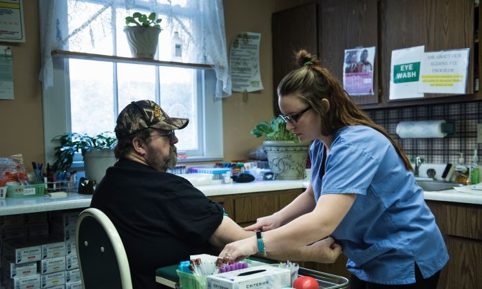 A patient has blood drawn in Burton, West Virginia, on March 22. (BRENDAN SMIALOWSKI/AFP/Getty Images)