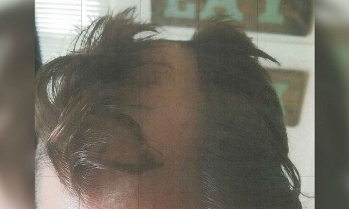 A 22-year-old man got on the wrong side of a hair stylist in Wisconsin who also allegedly snipped one of his ears with scissors. (Dane County (Wis.) Sheriff's Office)