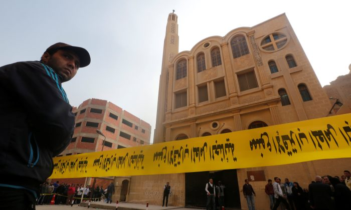 Police tape cordon is seen at the site of attack on a church in the Helwan district south of Cairo, Egypt Dec. 29, 2017. (Reuters/Amr Abdallah Dalsh)