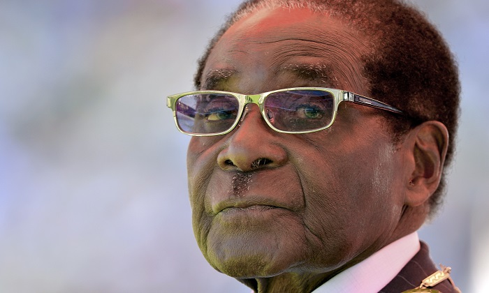 A 2013 file image of past Zimbabwean president Robert Mugabe whose 37-year rule was marked by accusations of human rights abuses, electoral deception and economic incompetence. (Alexander Joe/AFP/Getty Images)