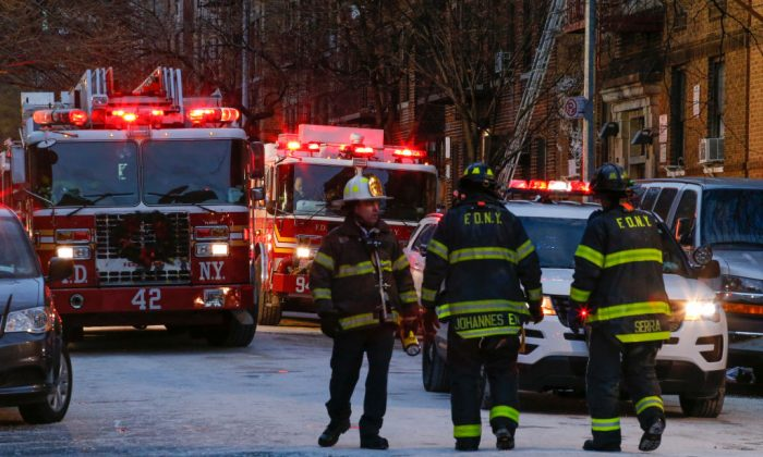 New York firefighters work at the scene of an apartment fire on Dec. 29, 2017, in the Bronx, New York City. Officials said Friday that the death toll from the fire has reached 12, including four children. (Kena Betancur/AFP/Getty Images)