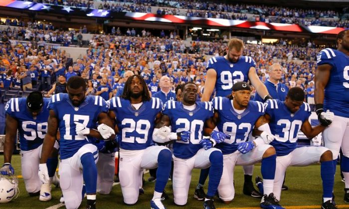 Members of the Indianapolis Colts stand and kneel for the national anthem prior to the start of the game between the Indianapolis Colts and the Cleveland Browns at Lucas Oil Stadium in Indianapolis, Indiana on Sept. 24, 2017. (Photo by Michael Reaves/Getty Images)