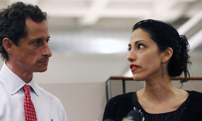 Anthony Weiner and his wife Huma Abedin, a close aide to Hillary Clinton, speak during a press conference in New York City on July 23, 2013. (John Moore/Getty Images)