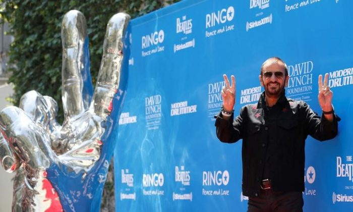 """Musician Ringo Starr poses during a """"Peace & Love"""" event to celebrate Starr's 77th birthday in Los Angeles, California, U.S., July 7, 2017. (Reuters/Mario Anzuoni)"""