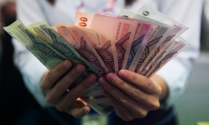 Up to 40,000 people in Thailand were duped out of their money by a Ponzi scheme. (Paula Bronstein/Getty Images)