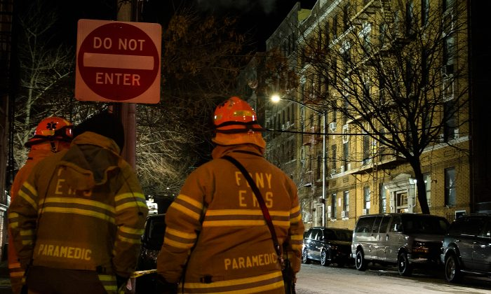 Twelve people died in the fire in the five-story Belmont apartment building on Dec. 28, 2017—one of them was 28-year-old Emmanuel Mensah, home on leave from the National Guard. (Amir Levy/Getty Images)