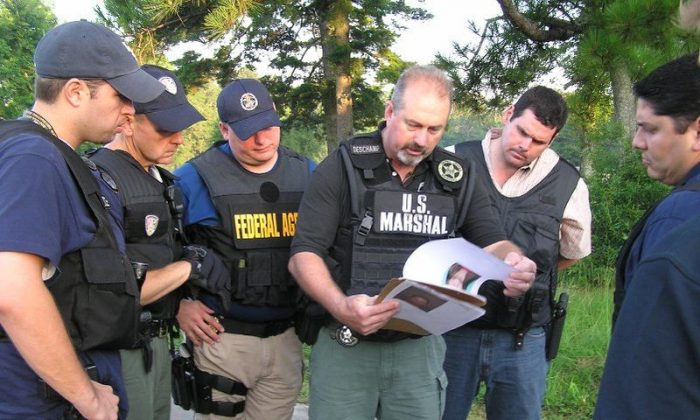 U.S. Marshal briefing for Operation Falcon (Federal And Local Cops Organized Nationally), on June 16, 2008. The U.S. Marshals teamed with its partners from federal, state, and local law enforcement to engage in the record-breaking initiative. It was the fifth effort in a continuing series of historically successful national fugitive apprehension missions, which have resulted in the collective capture of more than 55,800 dangerous fugitive felons. (Courtesy U.S. Marshal Service)