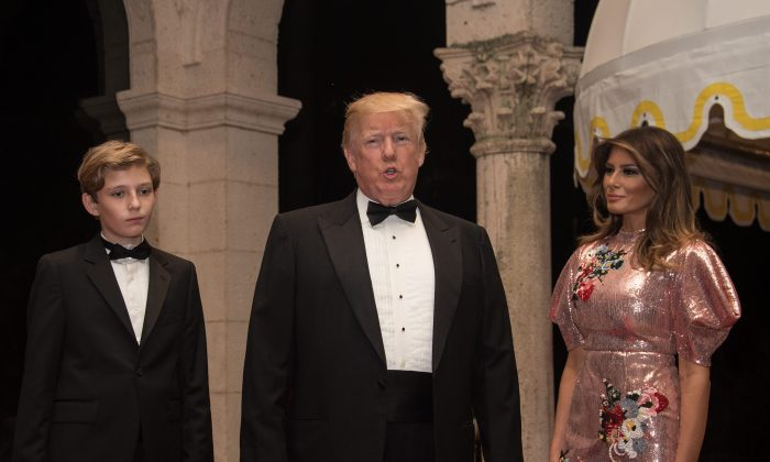 President Donald Trump, First Lady Melania Trump, and their son Barron arrive for a New Year's party at Trump's Mar-a-Lago resort in Palm Beach, Florida, on Dec. 31, 2017. (NICHOLAS KAMM/AFP/Getty Images)