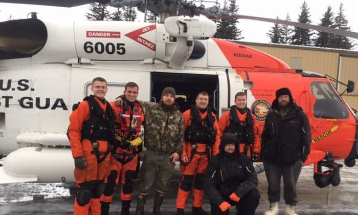 A Coast Guard Air Station Kodiak MH-60 helicopter crew pose with three men they rescued from Chenega Island, Alaska, Jan. 1, 2018.  (U.S. Coast Guard)