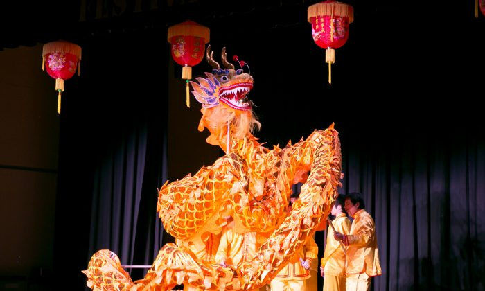 The dragon dance is performed on stage at the 10th Annual Chinese New Year Festival in Falls Church, Virginia, on Jan. 14, 2017. (Asian Community Service Center)