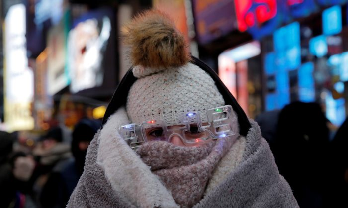 Elena Barduniotis from Colorado waits in Times Square ahead of New Year's celebrations in Manhattan. (Reuters/Andrew Kelly)