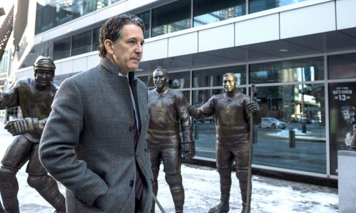 Toronto Maple Leafs president Brendan Shanahan at Legends Row outside the Air Canada Centre following the passing of Canadian hockey legend Johnny Bower, in Toronto on Dec. 27, 2017. (The Canadian Press/Christopher Katsarov)