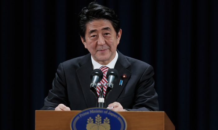 Prime Minister of Japan Shinzo Abe speaks during a press conference in the Asia-Pacific Economic Cooperation (APEC) Summit in Beijing, China, on Nov. 11, 2014. An alliance of Japan, India, and other south Asia and Pacific democracies could prove an effective counterweight to an expansionist Chinese regime. (Lintao Zhang/Getty Images)