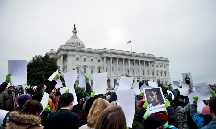People protest the termination of the Deferred Action for Childhood Arrivals (DACA) outside the Capitol Building on Capitol Hill, Washington, on Dec. 6, 2017. (BRENDAN SMIALOWSKI/AFP/Getty Images)