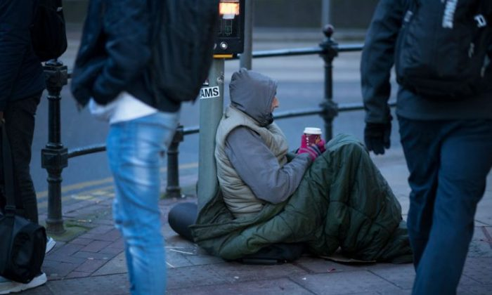 A homeless man begs for small change on the streets of Manchester on Dec. 11, 2017. (Christopher Furlong/Getty Images)
