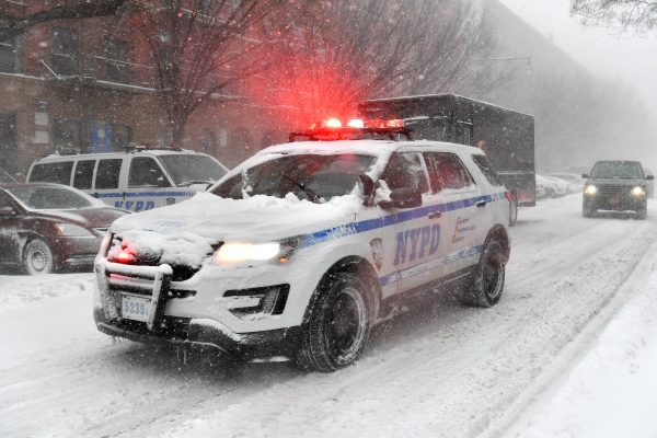 NEW YORK, NY - JANUARY 04: A NYPD vehicle drives through Harlem during a snow storm on January 4, 2018 in New York City. As a major winter storm moves up the Northeast corridor, New York City is under a winter storm warning and forecasts are calling for six to eight inches of snow. (Photo by Dia Dipasupil/Getty Images)