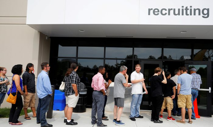 "Job seekers line up to apply during ""Amazon Jobs Day,"" a job fair being held at 10 fulfillment centers across the United States aimed at filling more than 50,000 jobs, at the Amazon.com Fulfillment Center in Fall River, Massachusetts, U.S., Aug. 2, 2017. (Reuters/Brian Snyder/File Photo)"