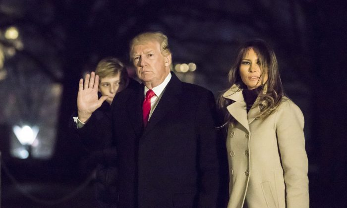 President Donald Trump, First Lady Melania Trump, and their son Barron Trump arrive at the White House in Washington, on Jan. 1, 2018. (Samira Bouaou/The Epoch Times)