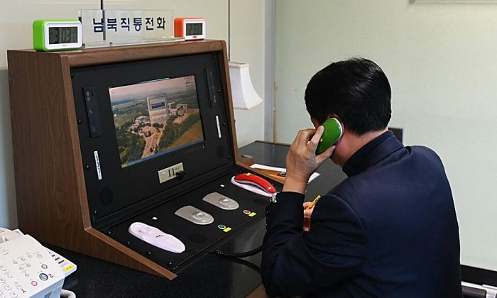 A South Korean government official checks the direct communications hotline to talk with the North Korean side at the border village of Panmunjom in Panmunjom, South Korea on Jan. 3, 2018. (South Korean Unification Ministry via Getty Images)
