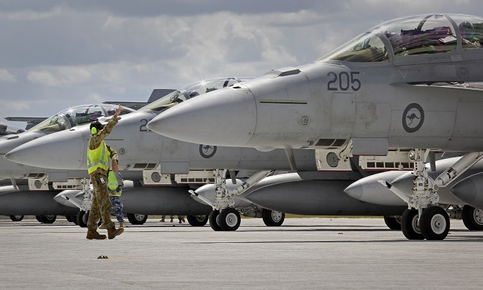 A file image of ground crews assisting a Royal Australian Air Force F/A-18F Super Hornets prepare for flight from a base in Amberley, Australia. (CPL Ben Dempster/Royal Australian Air Force via Getty Images)