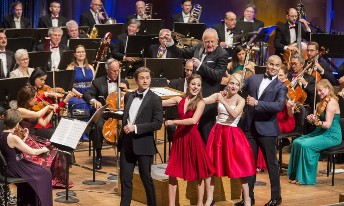 "(L–R) Aaron Tveit, Laura Osnes, Annaleigh Ashford, and Christopher Jackson, with Bramwell Tovey conducting The New York Philharmonic's tribute to Leonard Bernstein, ""Bernstein on Broadway."" (Chris Lee)"