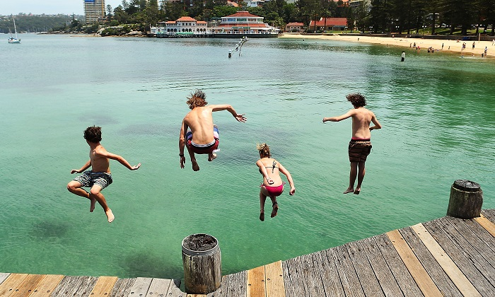 A file image of young people jumping off Manly Wharf in Sydney during an Aussie summer. (Brendon Thorne/Getty Images)